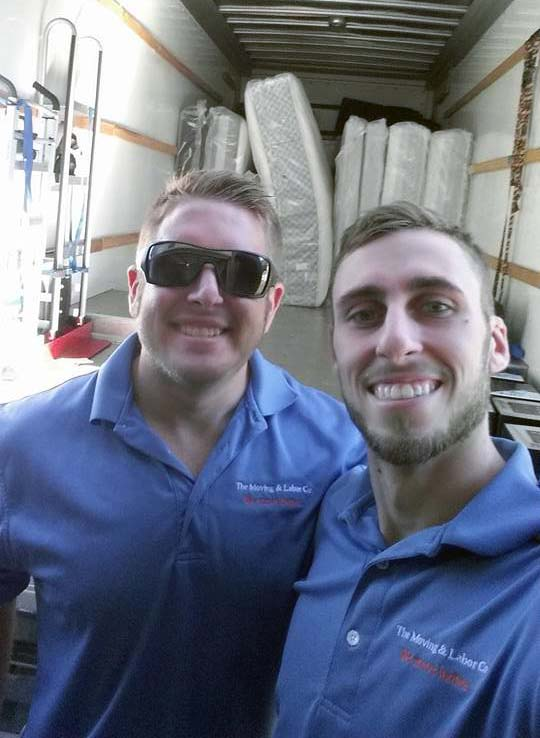 owners Robert and Phillip take a selfie inside one of The Moving Company's moving trucks